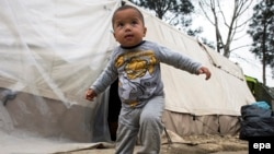 A refugee toddler at a makeshift camp near the Greek-Macedonian border near the Greek village of Idomeni, Greece, in March.