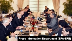 FILE: Pakistani Prime Minister Shahid Khaqan Abbasi (C-R) talks with U.S. Secretary of Defense Jim Mattis (C-L) during their meeting in Islamabad on December 4.