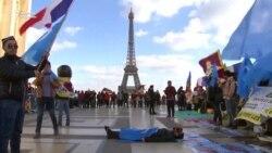 Қытай президентінің Францияға сапары кезінде жүздеген адам шеруге шықты