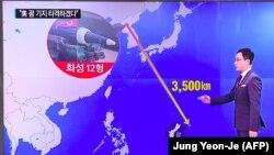 Приказ на оддалеченоста на Северна Кореја и Гуам на телевизиски екран во Јужна Кореја по заканите за напад на островот.