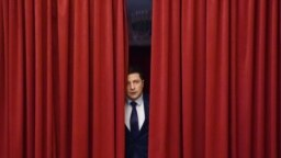"UKRAINE -- Ukrainian comic actor and the presidential candidate Volodymyr Zelenskiy enters a hall to take part in the shooting of the television series ""Servant of the People"", in Kyiv, March 6, 2019"