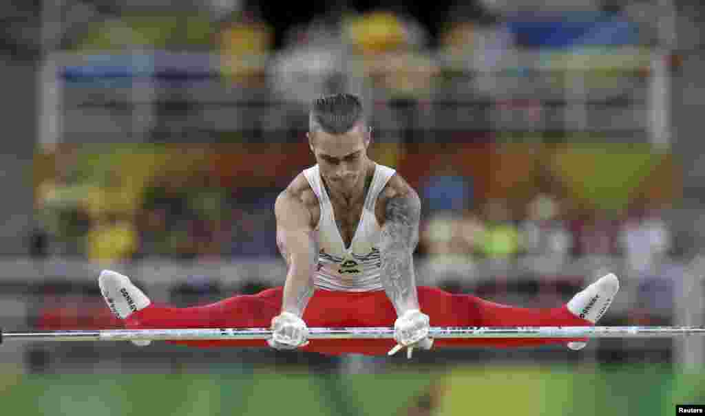 Azerbaijani gymnast Oleg Stepko competes during qualification on the horizontal bar.