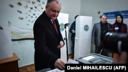 Moldovan President Igor Dodon casts his vote in parliamentary elections in a polling station in Chisinau on February 24.