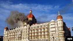 Firefighters try to douse a fire at the Taj hotel in Mumbai amid a deadly attack in November 2008.