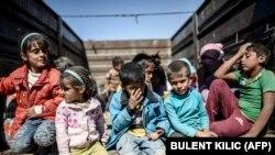 Syrian refugees on the Syrian-Turkish border near Suruc.