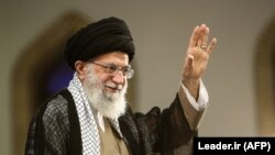 Iranian Supreme Leader Ayatollah Ali Khamenei gestures during a rally in Tehran on August 13.
