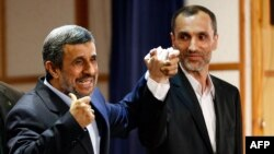 Former Iranian President Mahmud Ahmadinejad (left) stands with former Vice President Hamid Baghaei after registering at the Interior Ministry's election headquarters as candidates for the upcoming presidential election in Tehran on April 12.
