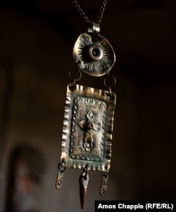 This crucifix pendant was crafted from a sniper round.