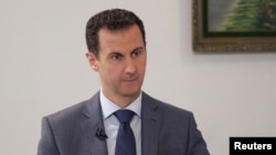 "Syrian President Bashar al-Assad downplayed the significance of Saudi- and Western-backed opposition forces in Syria -- saying it was important for what he called ""real"" opposition groups participate. (file photo)"