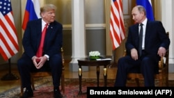 Russian President Vladimir Putin (right) and U.S. President Donald Trump (left) attend a meeting in Helsinki in July 2018.