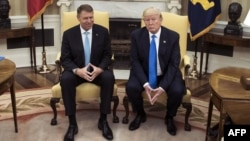 Romania's President Klaus Iohannis (left) met with U.S. President Donald Trump the White House in Washington, D.C., on June 9.