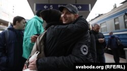 Dzmitry Paliyenka was greeted by family and friends at the main railway station in Minsk on October 24.