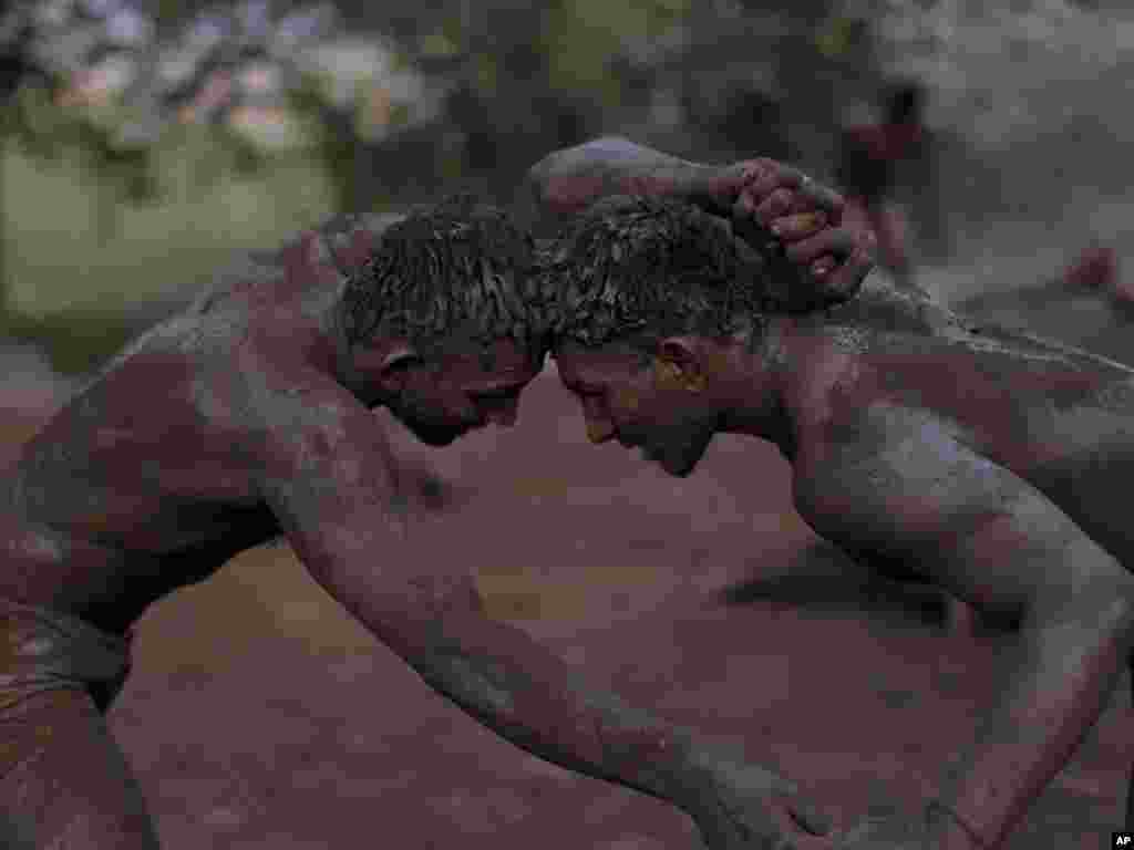 Pakistani Kushti wrestlers fight as part of their daily training in Lahore, Pakistan, on June 22.Photo by Muhammed Muheisen for AP