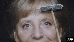 A campaign billboard in Berlin of Chancellor Angela Merkel, whose Christian Democrats looked in a position for reelection in late polling.