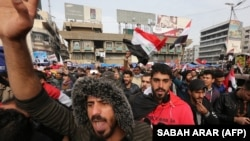 Iraqis gather at Tahrir square in the capital Baghdad amid ongoing anti-government protests on December 10, 2019