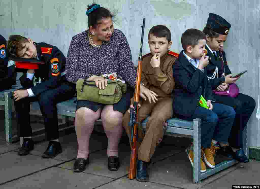 A mother speaks with her son before the beginning of the cadet movement members parade at Poklonnaya hill in Moscow on May 6. (AFP/Vasily Maksimov)