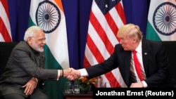 U.S. President Donald Trump shakes hands with India's Prime Minister Narendra Modi during a bilateral meeting alongside the ASEAN Summit in Manila, Philippines November 13, 2017