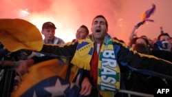 Supporters of the Bosnian national football team celebrate World Cup qualification.