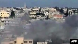Syria -- A video grab shows smoke billowing from the rebel bastion of Rastan, May2012