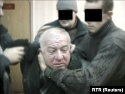 A still image taken from an undated video shows Skripal being detained by secret service officers in an unknown location.