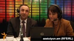 Armenia -- Minister of Justice Hrayr Tovmasian (L) and RFE/RL journalist Narine Ghalechian live on Azatutyun TV, Yerevan, 06Apr2011