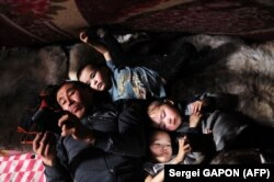 A nomadic family inside a tent in the remote Yamalo-Nenets region of northern Russia (file photo)