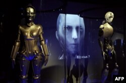 The Maschinenmensch (Machine-Person) from the film Metropolis by Fritz Lang (left) was displayed in an exhibition in Paris in 2012.