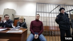 Russian opposition leader Aleksei Navalny (center) attends a court hearing in Moscow on February 28.
