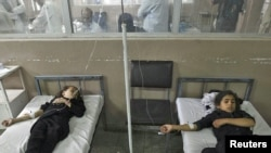 Schoolgirls receive treatment in a Kabul hospital