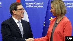 The EU's foreign policy chief, Federica Mogherini (right) welcomes Cuban Foreign Minister Bruno Rodriguez Parrilla at the start of an EU-Cuba political dialogue in Brussels on December 12.