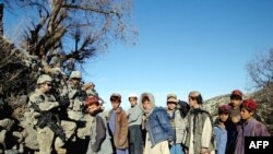 U.S. soldiers with Afghan children during a counternarcotics patrol in February 2009