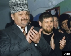 Akhmad Kadyrov (left) with his son Ramzan in March 2004