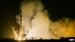 A Soyuz TMA-13M spacecraft carrying the ISS crew of Alexander Gerst (Germany), Maksim Suraev (Russia) and Reid Wiseman (U.S.A.) blasts off from the launch pad at the Baikonur cosmodrome in Kazakhstan on May 29.