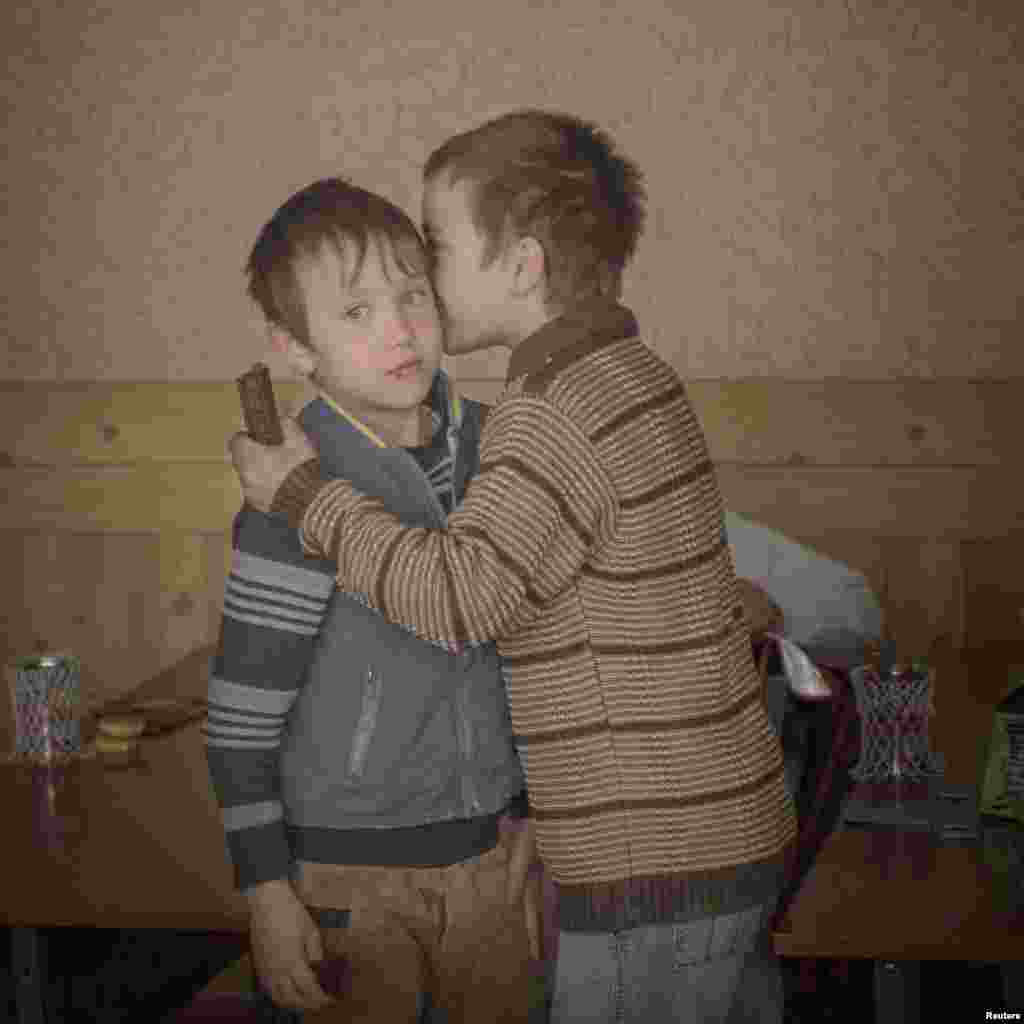 sa Sjostrom, a Swedish photographer working for Moment Agency, won Second Prize in the Daily Life Category, Singles, with this image of twin brothers Igor and Arthur handing out chocolates to their classmates to celebrate their ninth birthday in Baroncea, Moldova.
