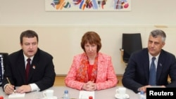 European Union foreign policy chief Catherine Ashton (center) poses with Serbia's Prime Minister Ivica Dacic (left) and Kosovo's Prime Minister Hashim Thaci in Brussels on April 19.