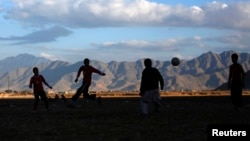 Youths play football in Kabul. (file photo)