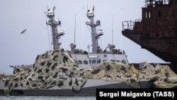 The Ukrainian naval ships seized by Russia are seen anchored at a port in Kerch on December 5.