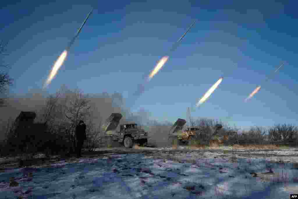Pro-Russian rebels stationed in the eastern Ukrainian city of Horlivka launch missiles from Grad launch vehicles. (AFP/Andrei Borodulin)
