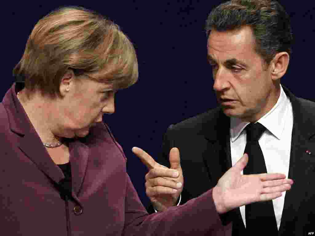 Francuski predsjednik Nicolas Sarkozy i njemačka kancelarka Angela Merkel, Kan, 02.11.2011. Foto: AFP / Thomas Coex