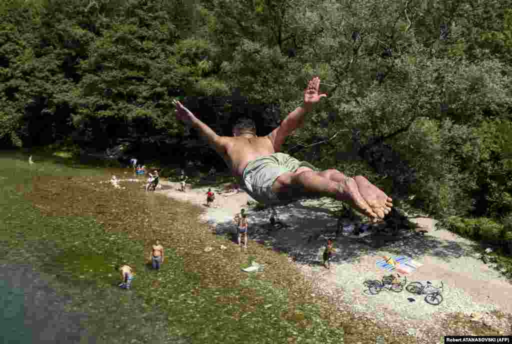 A young man dives in the Treska River near Skopje, Macedonia, on August 8 as temperatures soared to 37 degrees Celsius. (AFP/Robert Atanasovski)