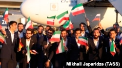 Members of the Iranian national soccer team arrive at Moscow's Vnukovo airport on June 5.