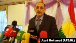 المفتش العام لوزارة العدل أمين عبد القادر الأسدي يتحدث في مؤتمر صحفي في السليمانية