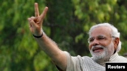 India -- Hindu nationalist Narendra Modi, the prime ministerial candidate for India's main opposition Bharatiya Janata Party (BJP), gestures during a public meeting in Vadodra, in the western Indian state of Gujarat May 16, 2014