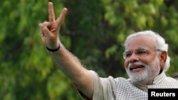 Narendra Modi, the prime ministerial candidate for India's main opposition Bharatiya Janata Party (BJP), gestures during a public meeting in Vadodra, in the western Indian state of Gujarat, on May 16.