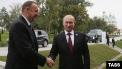 Azerbaijani President Ilham Aliyev (left) and Russian President Vladimir Putin are both implicated in the massive investigative report.