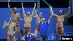 Serbia's bench celebrates a goal against Australia during their quarterfinal water-polo match.