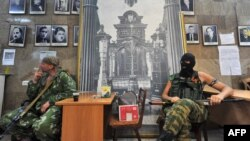 "Word of the ""partial withdrawal"" of Russian forces near the Ukraine border came one day after pro-Russian fighters of the so-called Vostok (East) Battalion evicted Ukrainian separatists and occupied (pictured) the regional state building in the eastern city of Donetsk on May 29."