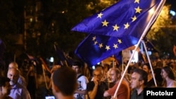 Armenia - Paruyr Hayrikian (L) and his supporters carry European Union flags on Marshal Bagramian Avenue, Yerevan, 2Jul2015.
