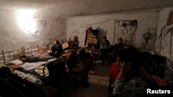NAGORNO-KARABAKH -- Civilians gather in the basement of an art art school used as a bomb shelter in the town of Martuni, October 14, 2020