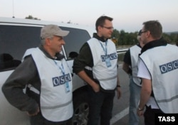 OSCE observers oversee an exchange of prisoners between the Ukrainian Army and pro-Russian rebels in Donetsk in late September.